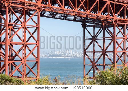 San Francisco Downtown in Hazy Summer Framed by the Golden Gate Bridge. San Francisco, California, USA.