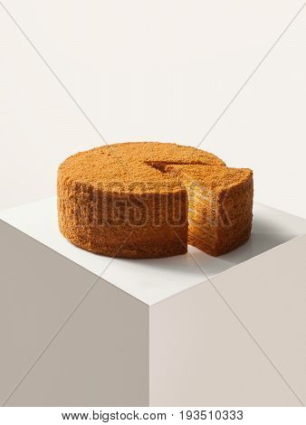 close up view of nice fresh yummy honey cake on white back