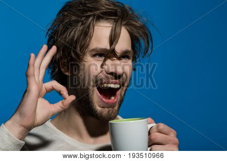 Ok Gesture Of Happy Man With Cup Of Tea