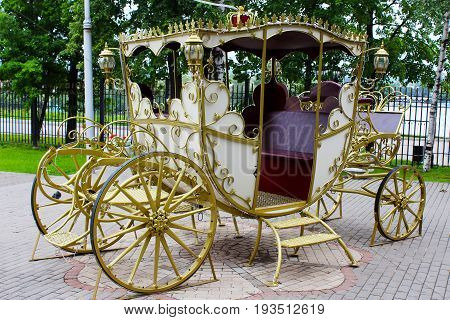 Golden carriage in the park retro outdoors object