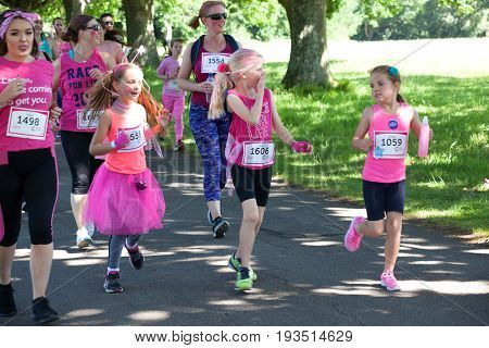 SOUTHAMPTON UK - July 2 2017: Race for Life women run and walk to raise money for Cancer Research charity in Southampton UK. Girls dressed up with tutu and accessories running and having fun.