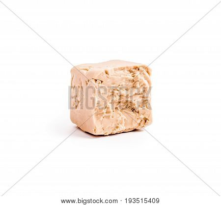 fresh yeast isolated on white background. bakery ingredient and supplement