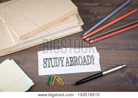 Study Abroad. Paper sheet from the booklet on the wooden table.