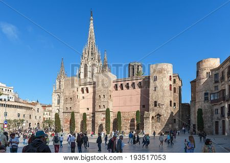 BARCELONA, SPAIN - MAY 2017: People walking near The Cathedral of the Holy Cross and Saint Eulalia, also known as Barcelona Cathedral in the Gothic quarter of Barcelona, Spain.