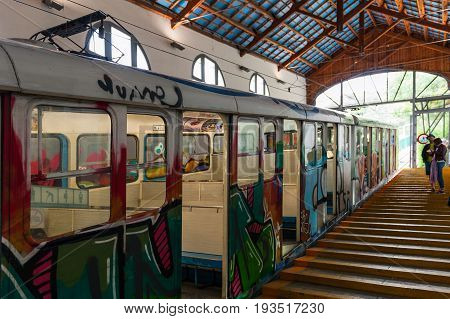 BARCELONA, SPAIN - MAY 2017: Old hippie style funicular train at station of Tibidabo attraction park.