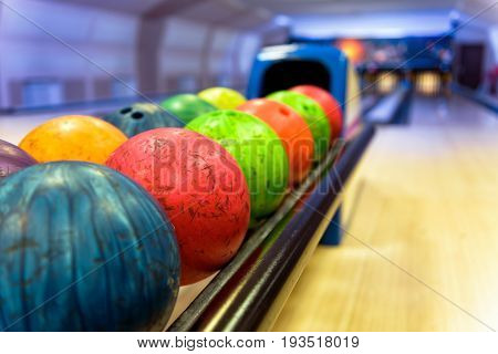 Bowling with colorful bowling balls in return machine