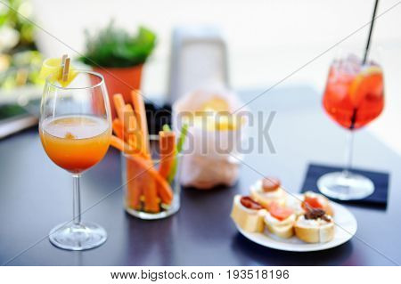 Italian Aperitives/aperitif: Two Glasses Of Cocktail And Appetizer Platter On The Table