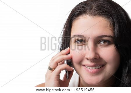 Smiley young woman speaking on mobile phone isolated on white background