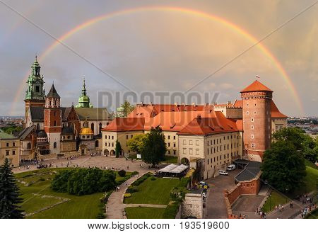 Krakow - Wawel castle in the evening and rainbow in the sky. Poland Europe.