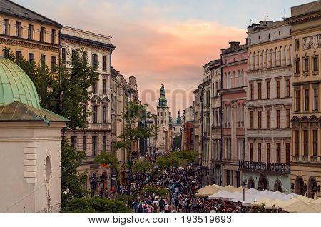 People goes by Grodzka street in Krakow Poland. Europe