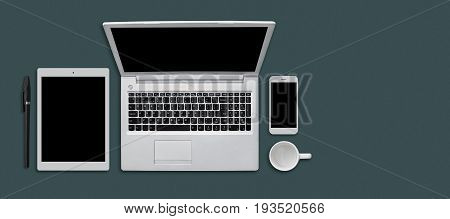Office Desk Table With Modern Gadgets, Cup And Pen. Modern Devices On Flat Surface: Tablet, Smartpho