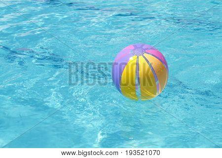 Beachball and swimmingpool. vacation close up image