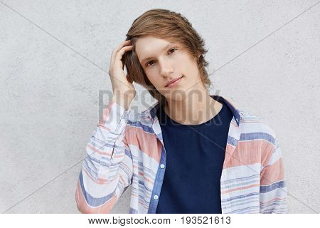 Stylish Teenager With Modern Hairstyle Wearing Shirt Isolated Over White Background Looking At Camer