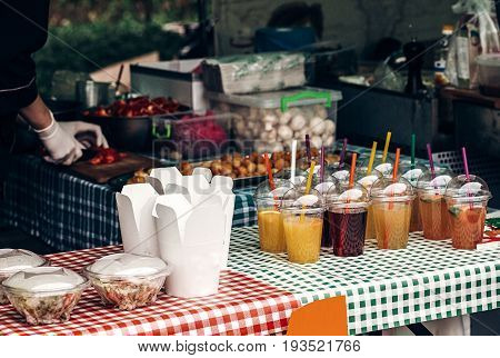 Colorful Lemonade On Table And Fast Food Paper Boxes, Space For Text. Street Food Festival. Drink Ba