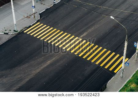 Yellow pedestrian crossing across the road, top view