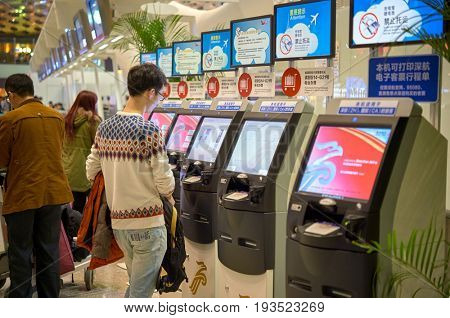 SHENZHEN, CHINA - FEBRUARY 16, 2015: self check-in kiosks at Shenzhen Bao'an International Airport.