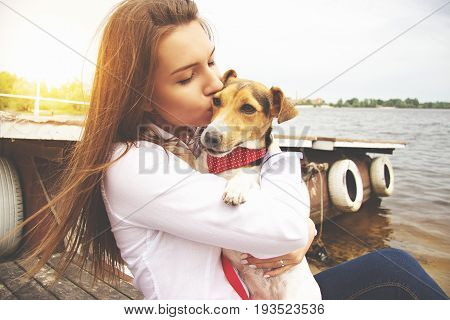 My Lovely Pet. Close-up Portrait Of Happy, Young And Beautiful Woman In Casual Clothes Is Kissing Li