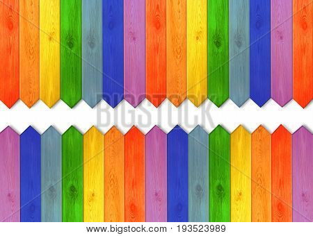 multicolored wooden boards in colors of rainbow. Multicolored wooden fence from colors of rainbow with white space in the middle. Empty place for text