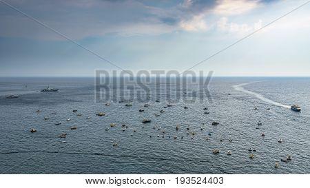 Boats on the Tyrrhenian sea on Amalfi coast at Positano town on a rainy day Campania Italy