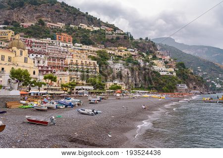 Positano Italy - Septamber 1 2016: View of the beach in famous and picturesque italian town on a clody day right after the rain.