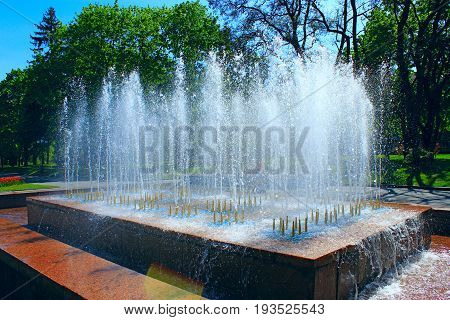 fountains in city park in hot summer day