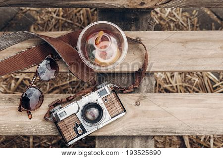 Hello Summer Vacation Top View. Lemonade Sunglasses Camera On Rustic Wooden Background At Summer Str