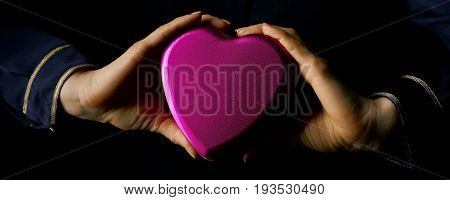 Female Hands Showing Heart Shaped Candy Box