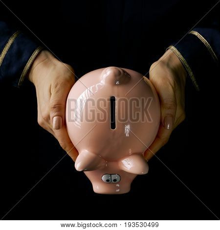 Female Hands Isolated On Black Showing Piggy Bank