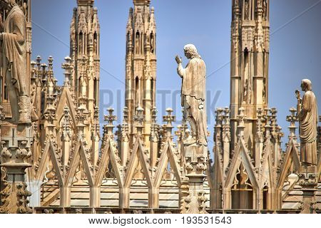 Architectural detail of milan cathedral, religious statue decor