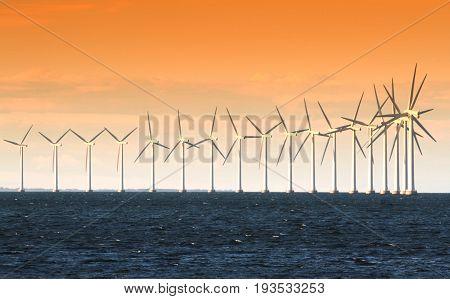Wind power generators on sea close up image
