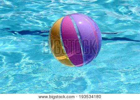 Beachball and swimmingpool sommer vacation close up image