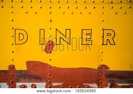 Abstract image of the side of a vintage diner wagon.