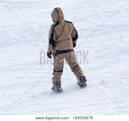 Athlete snow boarding in the snowy mountains . A photo