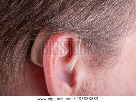 Close-up of a senior man's ear wearing hearing aid