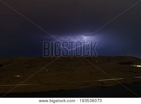 Lightning With Dramatic Clouds. Night Thunder-storm Over The Mountain And The Lake In Baku, Azerbaij