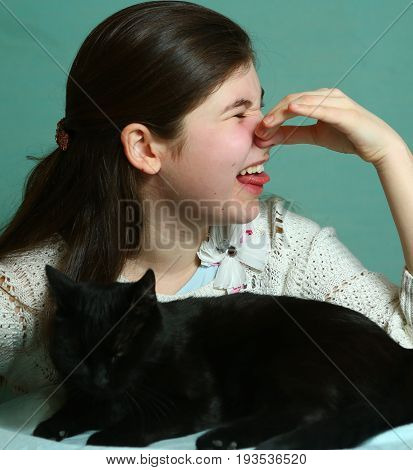 Teenager Girl Having Cat Allergy Close Up Sniff