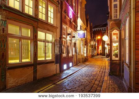 Medieval Bremen street Schnoor with half-timbered houses in the centre of the Hanseatic City of Bremen at night, Germany