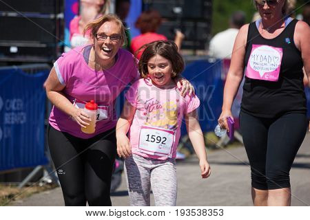 SOUTHAMPTON UK - July 2 2017: Race for Life women run and walk to raise money for Cancer Research charity in Southampton UK. Mother and daughter happy that they have completed race smiling.