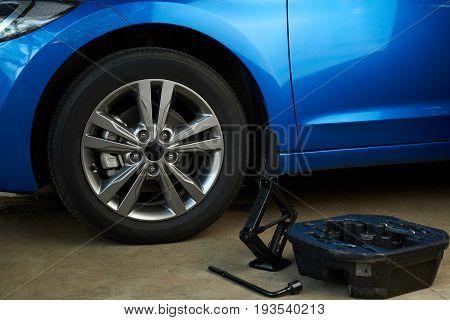 Equipment for changing car wheel. Change damage car wheel