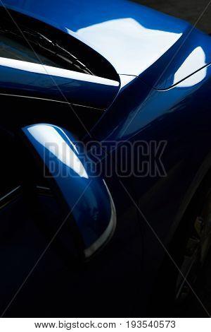 Detail of paint polished car. Shiny blue car hood