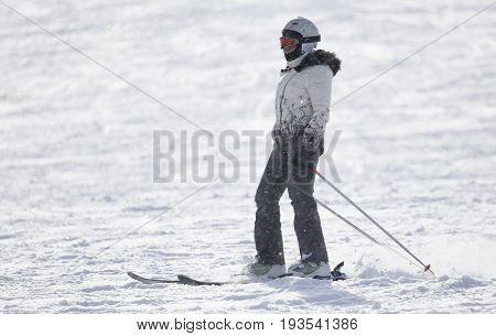 A woman on the slope.Skiing . A photo