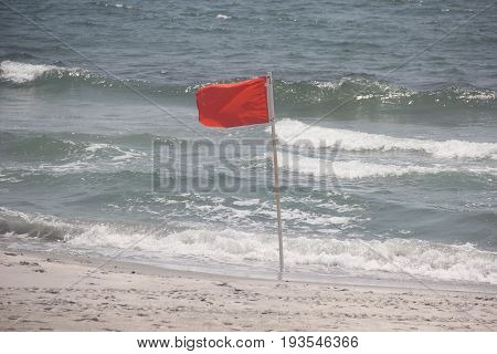 A red high surf flag on a beach in Atlantic City, New Jersey