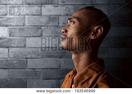 Asian man in prison thinking about freedom