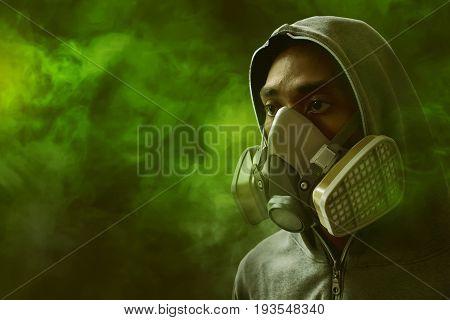 Man wearing respirator mask on poison gas background