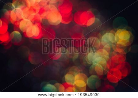 Abstract blurred light background, colorful halo. Glitter in bokeh. Christmas wallpaper decorations concept. New year holiday festive backdrop. Sparkle circle celebrations display.