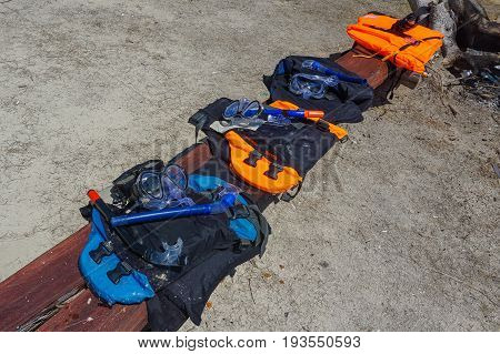 Labuan,Malaysia-May 1,2017:Various of life vests or life jackets is hung for drying out in Rusukan Besar island,Labuan,Malaysia.It is filled with buoyant material and used as a life preserver.