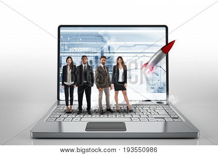 Team on a big laptop with a rocket ready to start. Concept of startup and innovation in business affairs. 3D Rendering