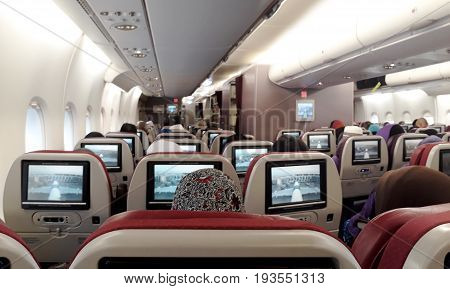People in airplane interior seats view during a flight