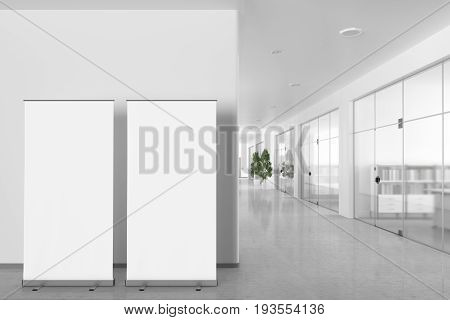 Blank Roll Up Banner Stand In Modern Office Interior