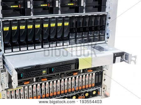 Rack mounted system storage and blade servers isolated on the white